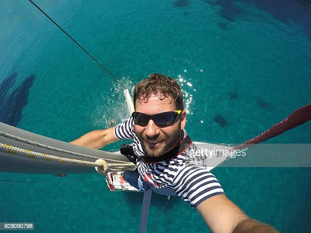 Selfie from top of the sailboat mast
