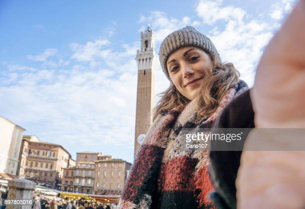 selfie in siena in winter - siena italy stock pictures, royalty-free photos & images