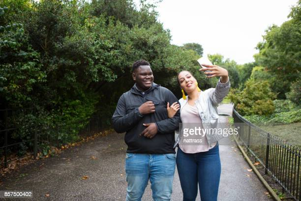 selfie in the park - battersea park stock pictures, royalty-free photos & images