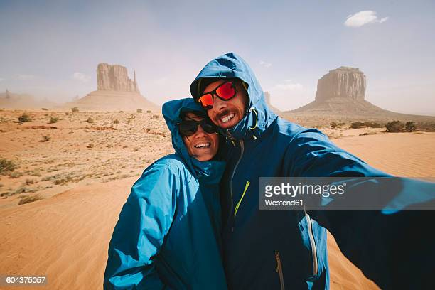 Selfie of a couple in the Monument Valley in Utah