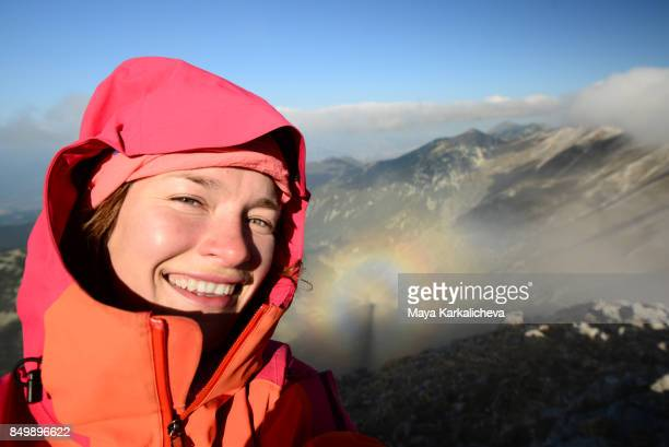 selfie of a female hiker with brocken spectre optical phenomenon shadow - light natural phenomenon stock pictures, royalty-free photos & images