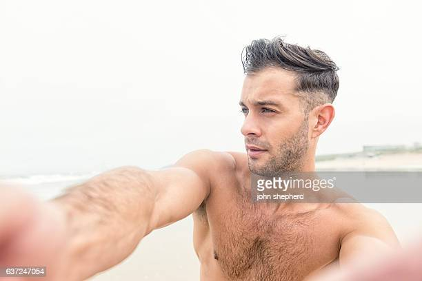 POV Selfie of a handsome man at the beach.