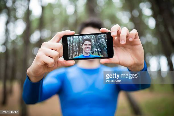 Selfie of a runner on the display of a smartphone
