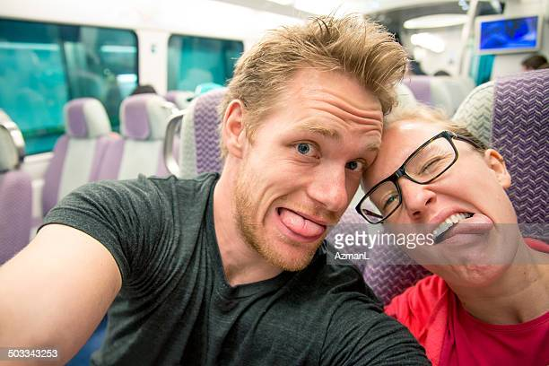 Selfie of a young couple on a train
