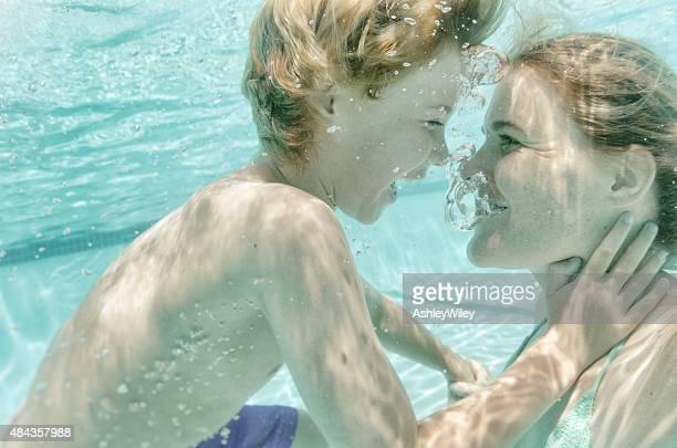 Selfie of boy and mom under water