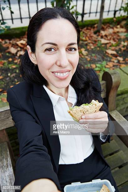 selfie of businesswoman having lunch outdoors - one mid adult woman only stock pictures, royalty-free photos & images
