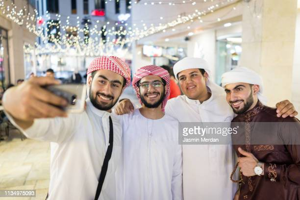 selfie of cheerful group of people - saudi stock pictures, royalty-free photos & images