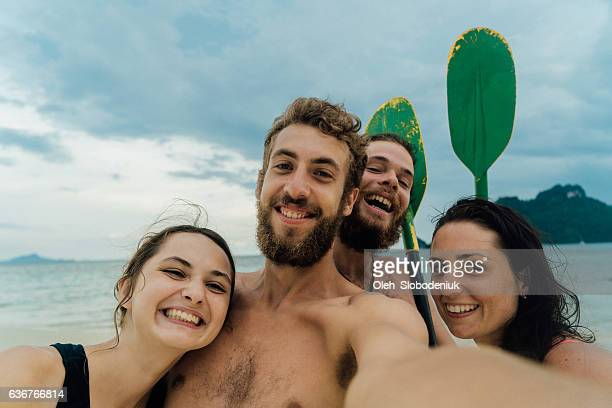 Selfie of friends with puddles on the beach