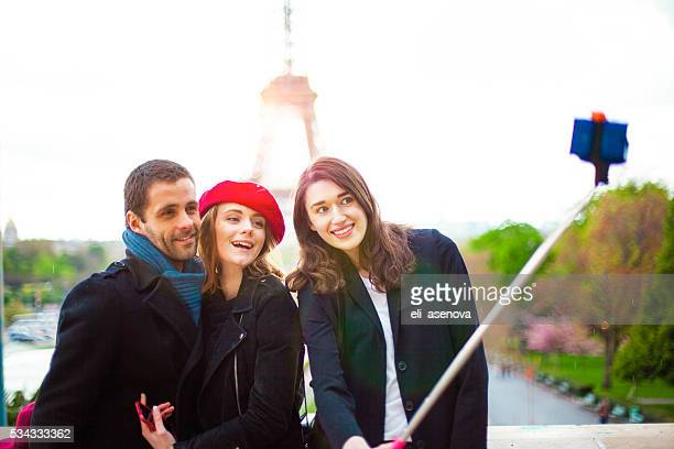 Selfie of Group friends on the Eiffel Tower