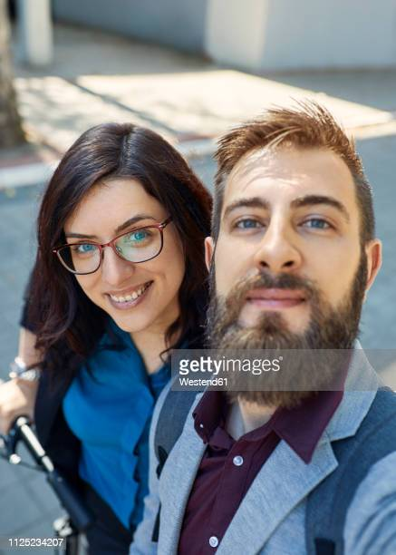 selfie of happy business couple with scooter - heterosexual couple stock pictures, royalty-free photos & images