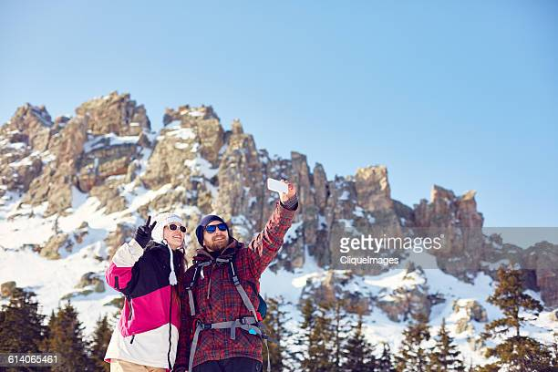selfie of hikers against a mountain - cliqueimages stock pictures, royalty-free photos & images