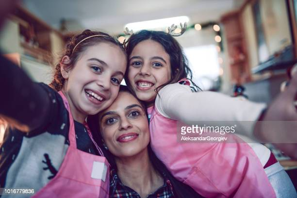 Selfie Of Mother And Daughters Having Fun In Kitchen Together