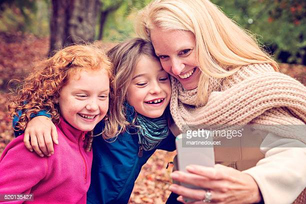 """selfie of mother and daughters outdoors in autumn nature. - """"martine doucet"""" or martinedoucet stock pictures, royalty-free photos & images"""