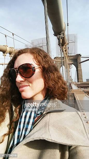 Selfie of RedHead Woman at NYC Brooklyn Bridge Travel Destination