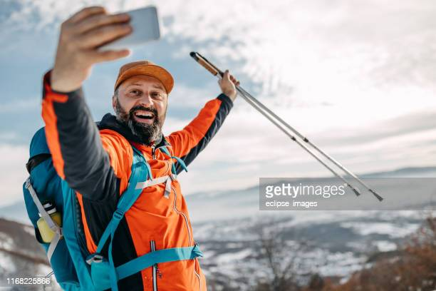 selfie of senior hiker - hiking pole stock pictures, royalty-free photos & images