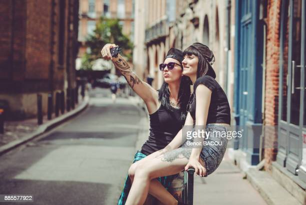 Selfie of two young women in an urban landscape