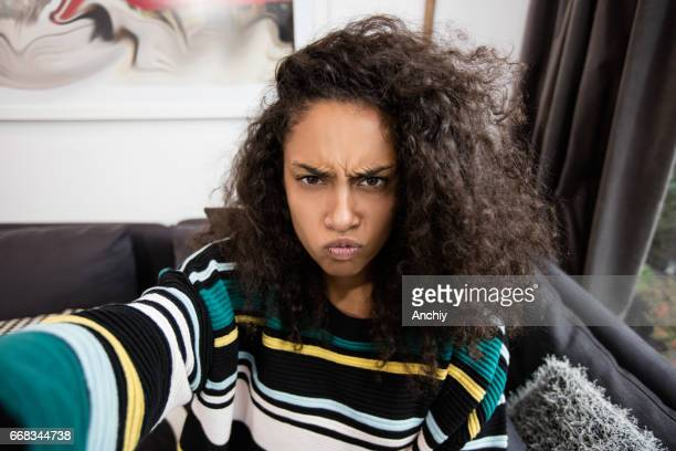 selfie of woman doing angry face