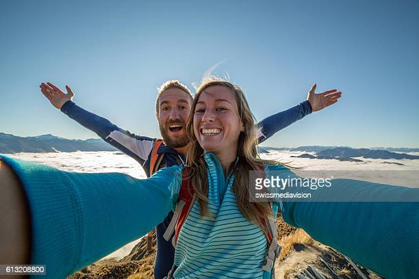 Selfie of young couple above the clouds