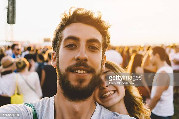 Selfie of young couple on festival