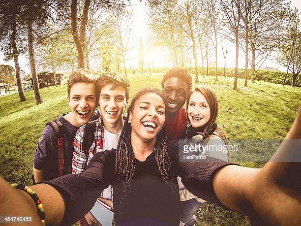 selfie of young multiethnic friends in a park - wide angle stock pictures, royalty-free photos & images