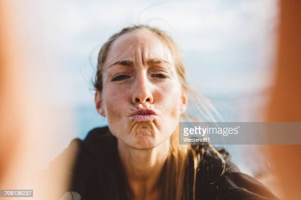 Selfie of young woman pouting