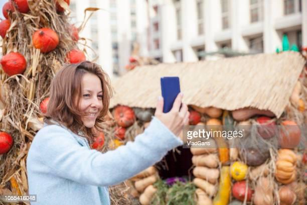 Selfie on the background of pumpkins