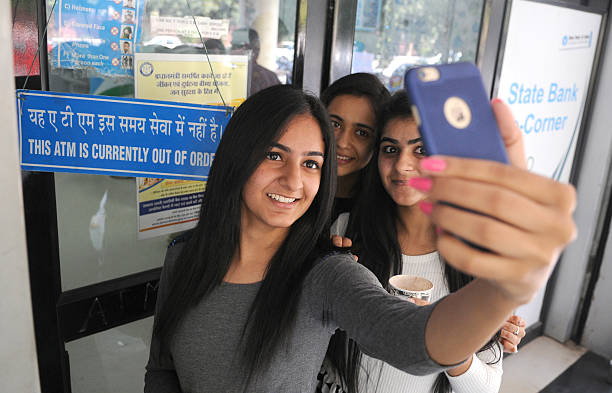 Selfie outside closed ATM at Panjab University branch on November 10 2016 in Chandigarh India It was a manic rush outside most banks across the...
