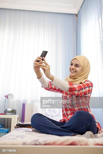 selfie - beautiful arab girl stock photos and pictures