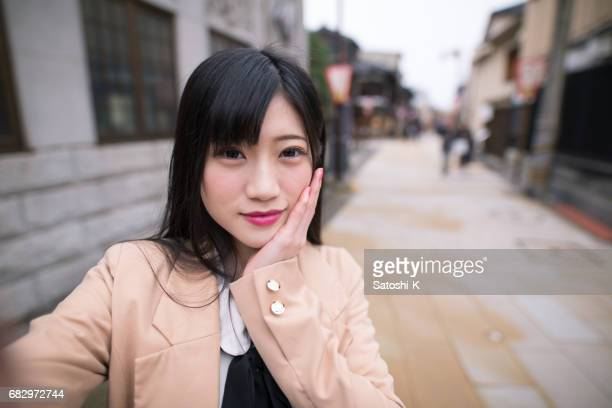selfie picture of young woman on street - photographing self stock pictures, royalty-free photos & images