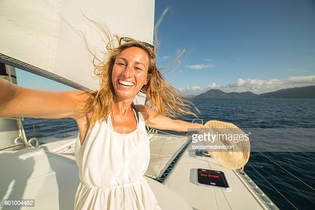 selfie portrait of blond girl on sailing boat - catamaran stock photos and pictures