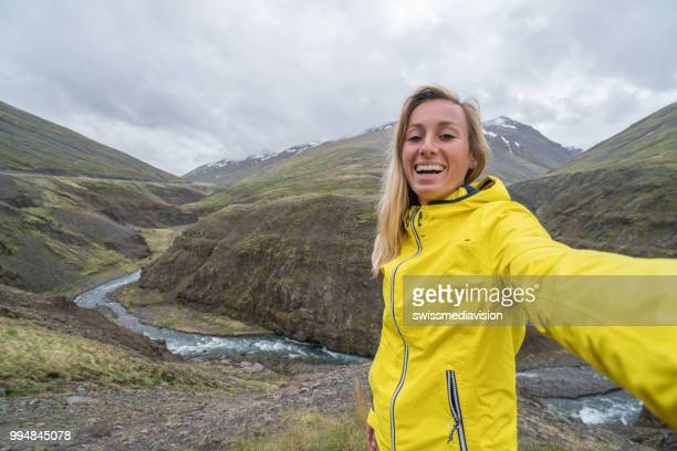 Selfie portrait of female on top of canyon, Springtime. People travel carefree lifestyles concept