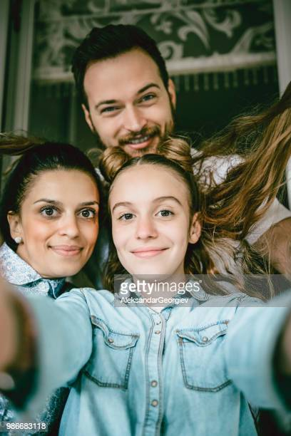 selfie portrait of happy family having fun at home - vertical stock pictures, royalty-free photos & images