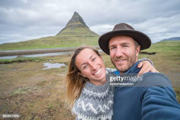 Selfie portrait of tourist couple in Iceland at Kirkjufell mountain