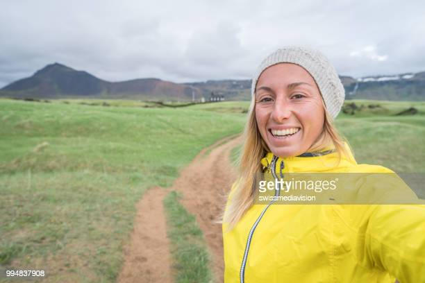 Selfie portrait of tourist female in Iceland