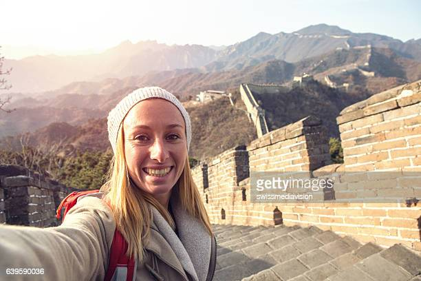 Selfie portrait of young woman on Great Wall of China