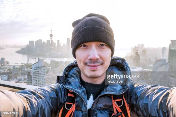 selfie portrait on rooftop shanghai china - asien stock-fotos und bilder