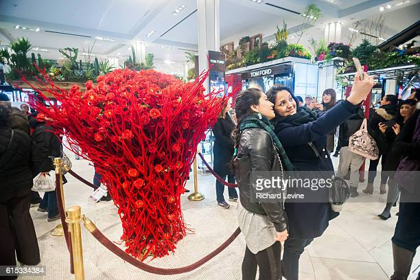 Selfie time in front of the Bouquet of the Day by Kenji Takenada in Macy's flagship department store in Herald Square in New York during the 42nd...