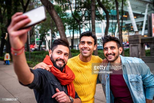 selfie time. - only men stock pictures, royalty-free photos & images