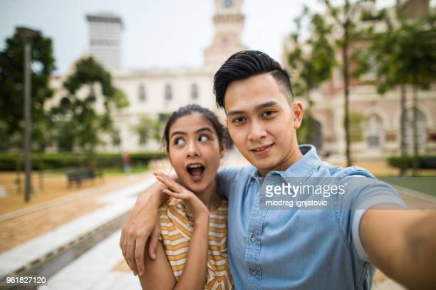 selfie time - malaysian culture stock pictures, royalty-free photos & images