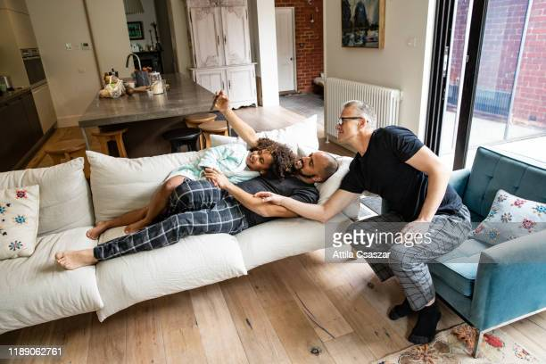 selfie time with lgbtqi family at home - thisisaustralia stock pictures, royalty-free photos & images