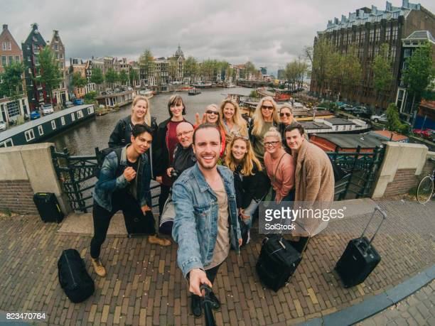 selfie with a group of friends on vacation - tourism stock pictures, royalty-free photos & images
