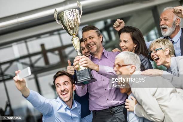 selfie with a trophy! - trophy award stock pictures, royalty-free photos & images