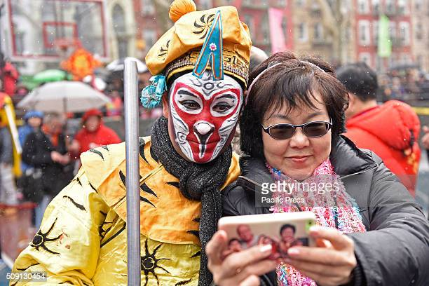 Selfie with costumed painted character Much of Lower Manhattan came alive in sound and color as the Year of Monkey was ushered in with pyrotechnics...
