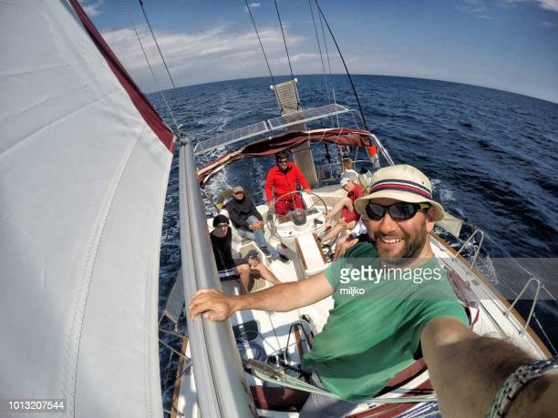 selfie with crew on sailboat - sailing team stock pictures, royalty-free photos & images