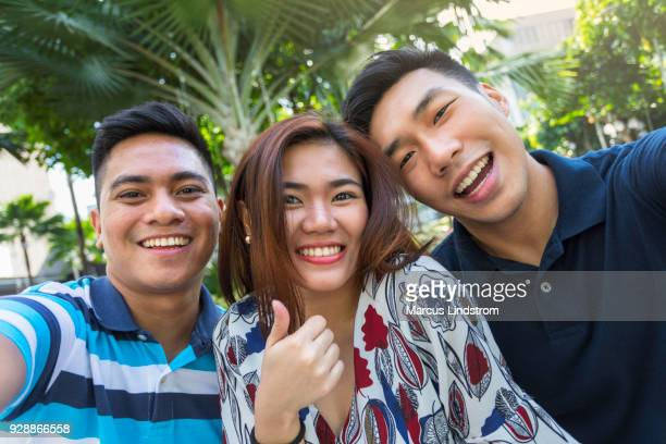 selfie with friends - manila philippines stock pictures, royalty-free photos & images