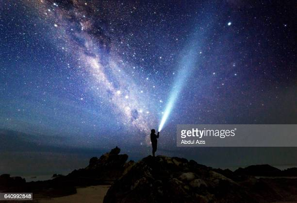 selfie with milkyway at sawarna beach bayah indonesia - indonesia photos stock photos and pictures