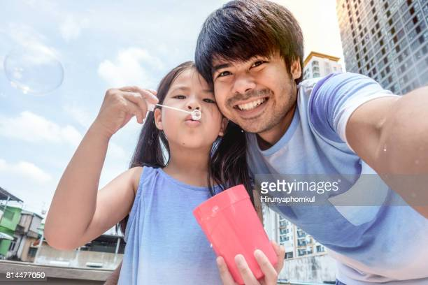 Selfie with my daughter playing bubble on a rooftop at home