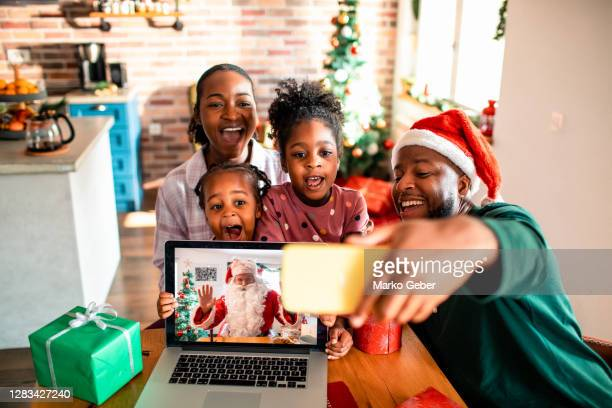 selfie with santa claus at home - father christmas stock pictures, royalty-free photos & images