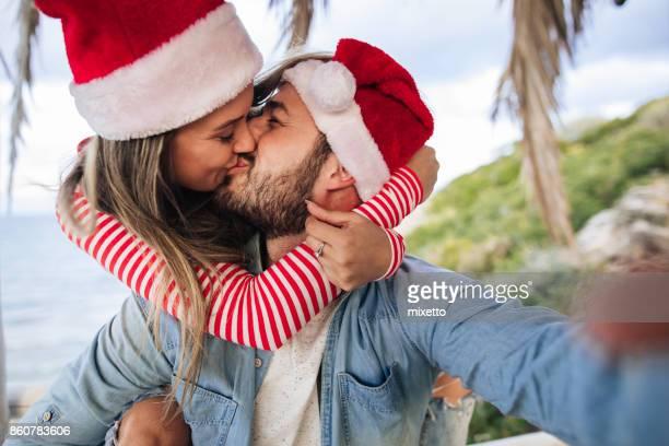 Selfie mit Weihnachtsmann-Mützen