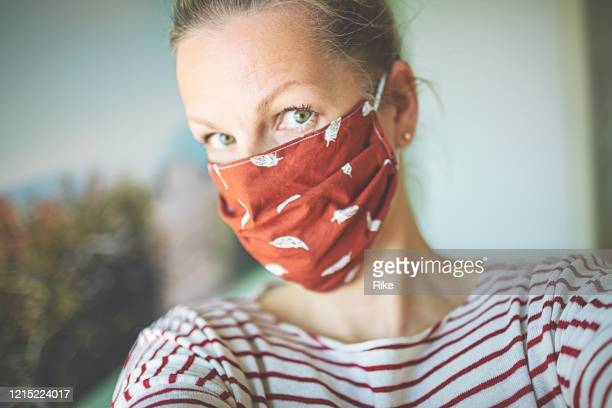 selfie with self-made mask to protect against viruses and bacteria - respirator mask stock pictures, royalty-free photos & images